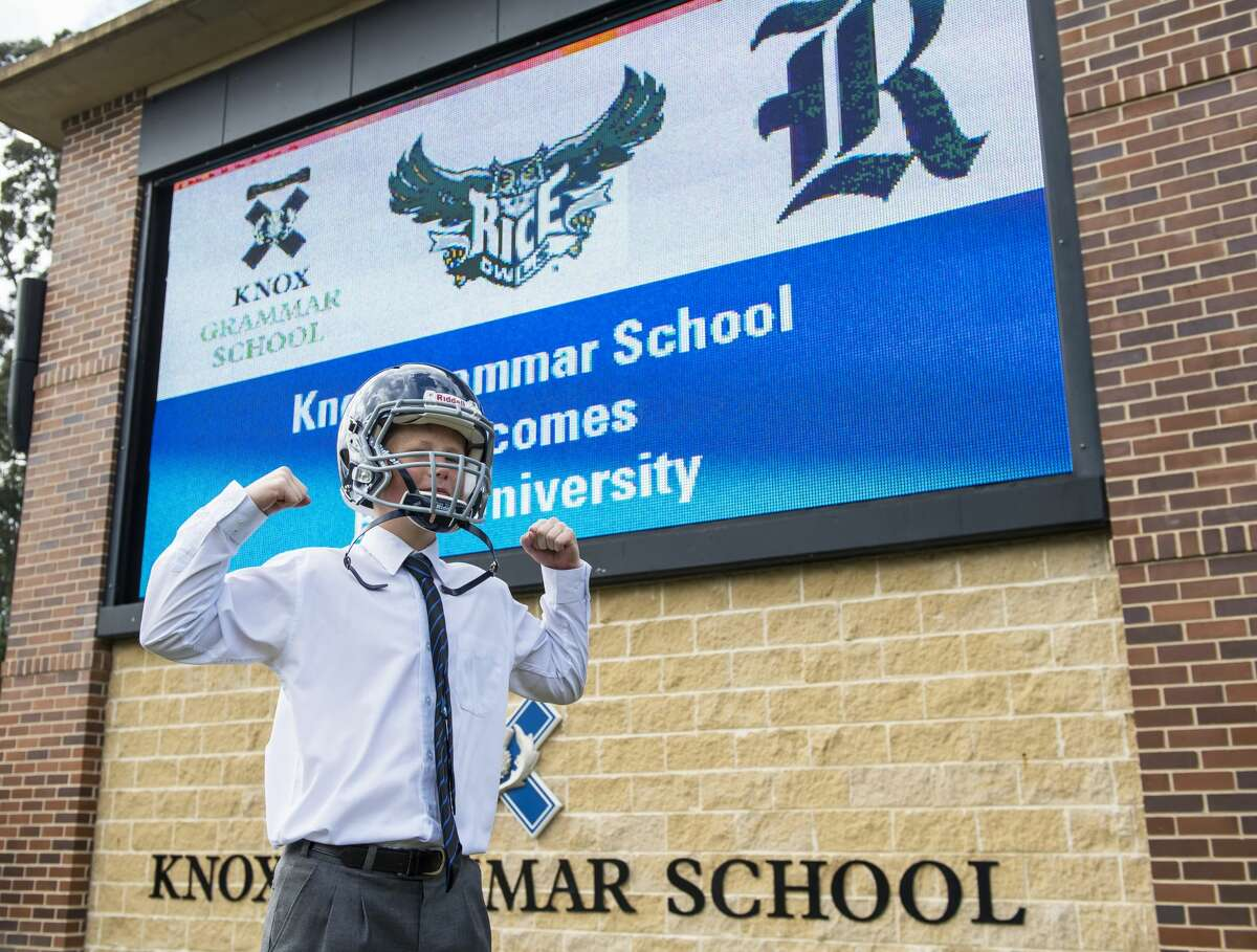 A student poses with a Rice football helmet at Knox Grammar School in New South Wales, Australia.