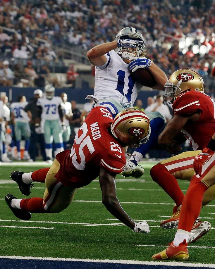 Dallas Cowboys wide receiver Cole Beasley (11) is tackled by San Francisco 49ers strong safety Jimmie Ward (25) and strong safety Antoine Bethea, right, during the second half of an NFL football game, Sunday, Sept. 7, 2014, in Arlington, Texas. (AP Photo/LM Otero) Photo: LM Otero, AP