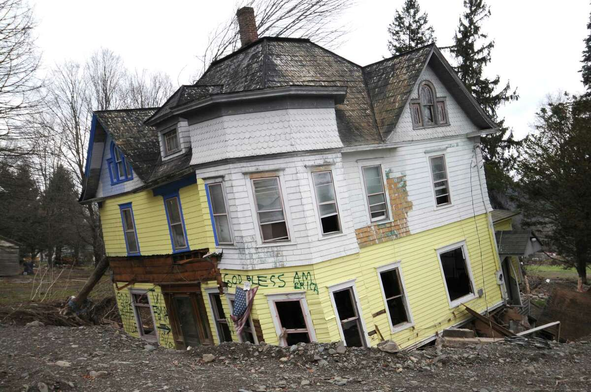 View of a devastated home on Main Street on Thursday Nov. 17, 2011 in Prattsville, NY, destroyed by flooding from Tropical Storm Irene. (Philip Kamrass / Times Union )