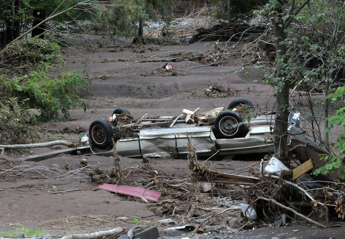 A washed up car lays in mud near the Schoharie Creek in Jewett Center, N.Y. on Sept. 8, 2011. (Lori Van Buren / Times Union)