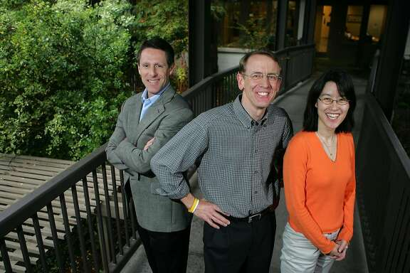 Venture capitalist John Doerr, middle, poses for a portrait with partners John Denniston, left, and  Ellen Pao outside of their office in Menlo Park, Calif., April 4, 2006. Doerr is betting on an emerging sector known as clean technology with plans to devote $100 million to green technologies that help provide cleaner energy, transportation, air and water. (AP Photo/Marcio Jose Sanchez) --- Sent 05/22/12 17:29:55 as energy09_PH_jump with caption: