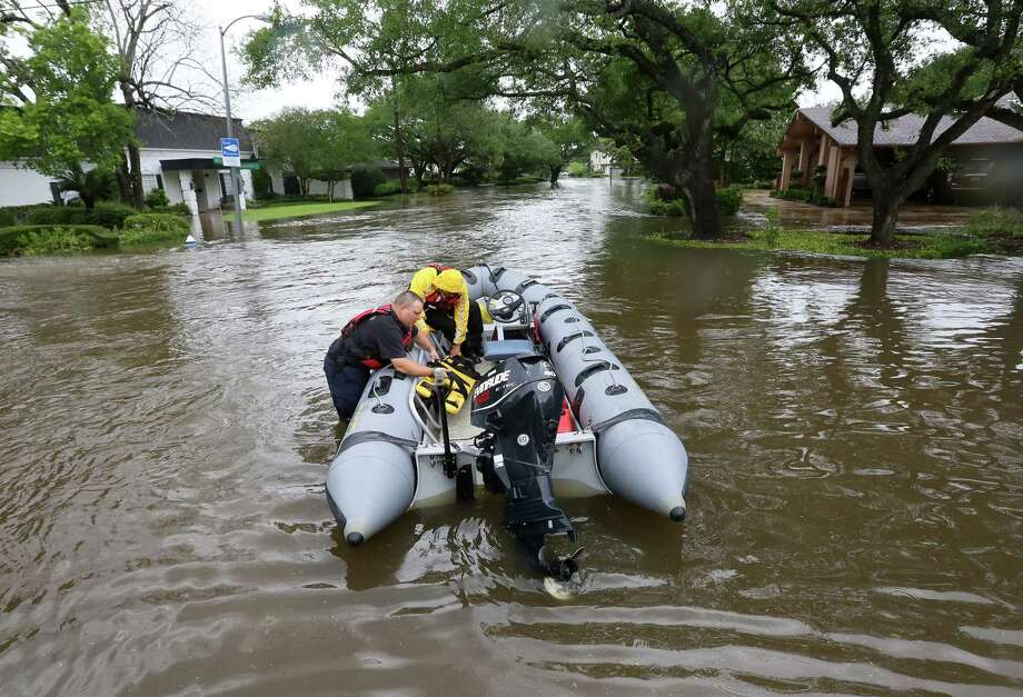 Houston Fire Department firefighters prepare a search and rescue mission in the Meyerland area after 2016 heavy rains caused Brays Bayou to flood nearby neighborhoods in Houston.  ( Jon Shapley / Houston Chronicle ) Photo: Jon Shapley, Staff / © 2015  Houston Chronicle