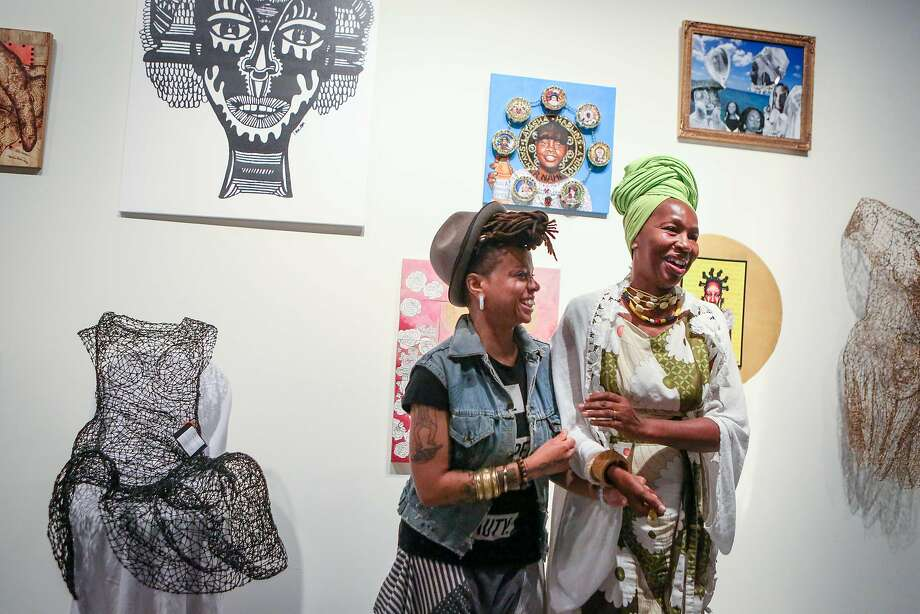 """Melorra Green (left) and Karen Seneferu conceived """"The Black Woman Is God"""" exhibition. Photo: Amy Osborne, Special To The Chronicle"""