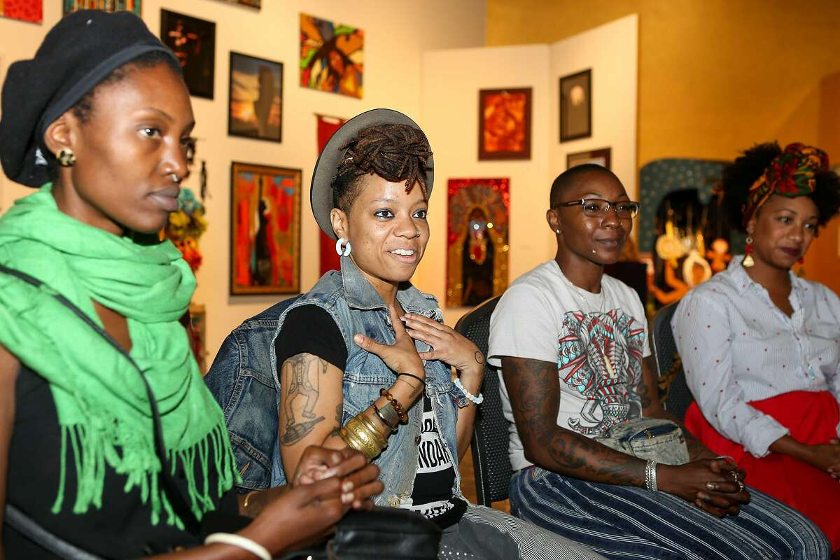 (Left to Right) Aambr Newsome, Melorra Green, Toshia Christal, and Ayana Ivery talk about their art work displayed in the Black Woman Is God exhibition at SOMArts on Wednesday, August 23, 2017 in San Francisco, Calif.