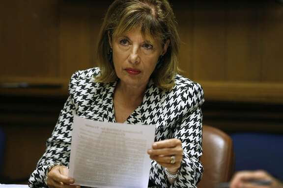 Rep. Jackie Speier distributes a list of Russians known to have links with Trump properties during a meeting with the Chronicle editorial board in San Francisco, Calif. on Thursday, Aug. 24, 2017.