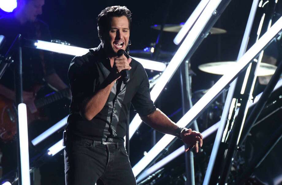 "FILE - In this Nov. 2, 2016, file photo, Luke Bryan performs ""Move"" at the 50th annual CMA Awards at the Bridgestone Arena in Nashville, Tenn. Video shows Bryan slapping a heckler with his fingers while still holding the microphone during a show in Nashville on Nov. 30, 2016. Bryan then continued with the song seeming unfazed by the incident.(Photo by Charles Sykes/Invision/AP, File) ORG XMIT: PAPM103 Photo: Charles Sykes / 2016 Invision"
