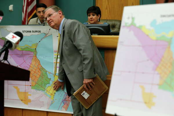 Corpus Christi mayor Joe McComb (center) points to a map of low lying areas in the city whose residents have been asked to voluntarily evacuate due to the impending landfall of Hurricane Harvey on Thursday, Aug. 24, 2017. Concerns over the growing tropical storm has moved officials to ask citizens to voluntarily leave Corpus Christi. Port Aransas was under a mandatory evacuation though some residents have opted to ride out the storm.