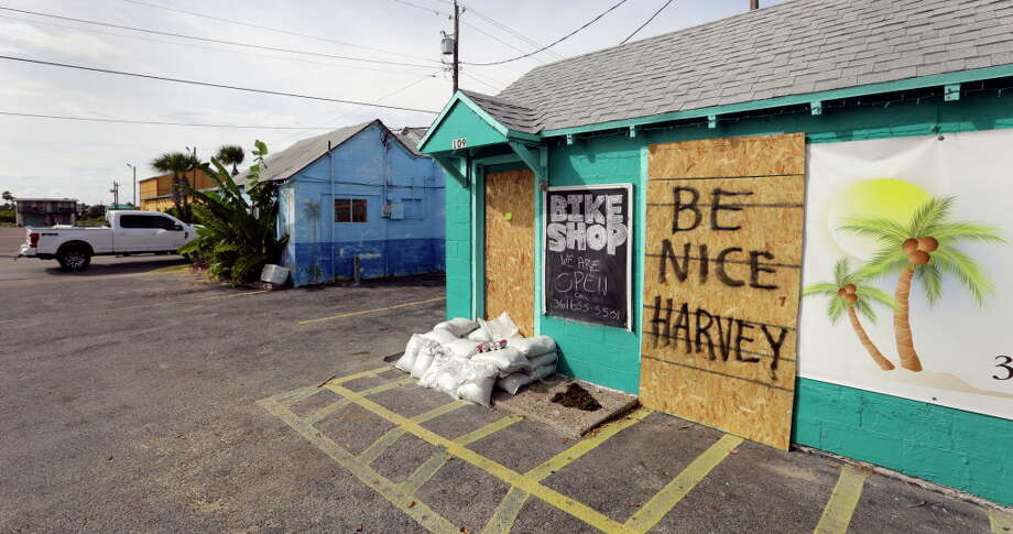 "A sign reading ""Be Nice Harvey"" was left behind on a boarded up business, Thursday, Aug. 24, 2017, in Port Aransas, Texas. Port Aransas is under a mandatory evacuation for Hurricane Harvey. Harvey intensified into a hurricane Thursday and steered for the Texas coast.See more images from Hurricane Harvey and the preparations for the storm. Photo: Eric Gay, Associated Press / Copyright 2017 The Associated Press. All rights reserved."