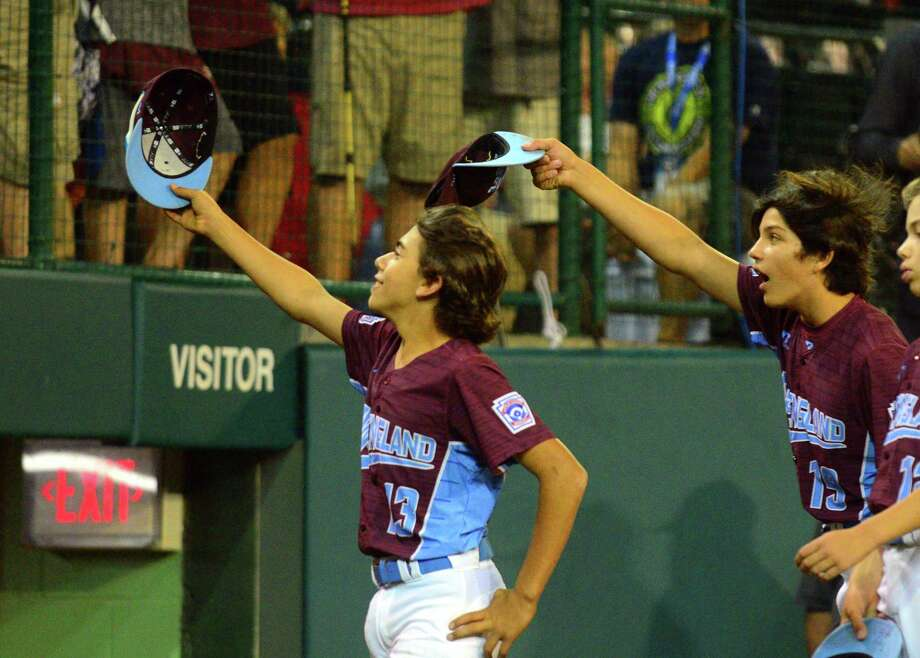 Fairfield American's Ethan Righter, left, and Christian Smith tip their ball caps to their families at the end of the road in Little League World Series action against Lufkin, TX at Lamade Stadium in South Williamsport, Penn., on Thursday Aug. 24, 2017. Photo: Christian Abraham, Hearst Connecticut Media / Connecticut Post