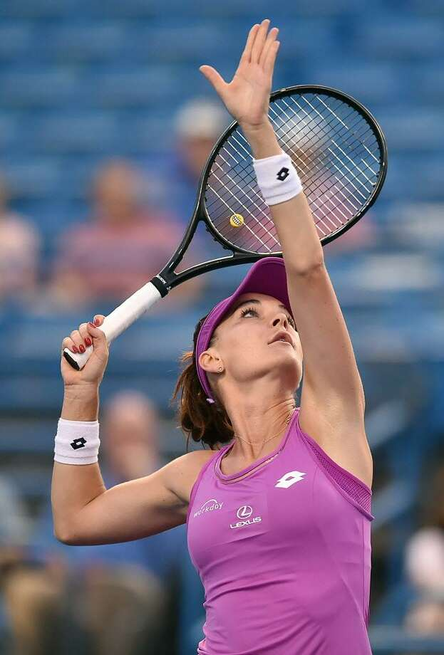 Defending champion, Poland's Agnieszka Radwanska returns a volley against Shuai Peng, of China, Thursday evening, August 24, 2017, in the quarterfinals of the Connecticut Tennis Open at the Stadium Court at the Connecticut Tennis Center in New Haven. Radwanska defeated Shuai Peng, 7-5, 6-3. (Catherine Avalone/Hearst Connecticut Media) Photo: Catherine Avalone / Hearst Connecticut Media / New Haven Register