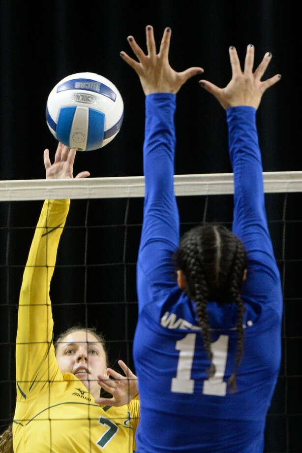 Midland College's Kristen Johnson (7) hits against Western Texas College's Adrianha Kirk (11) on Wednesday, Oct. 12, 2016, at Chaparral Center. James Durbin/Reporter-Telegram