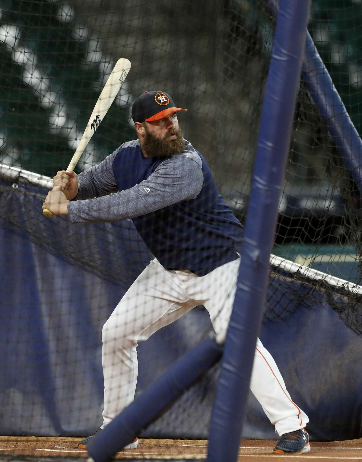 Houston Astros catcher Evan Gattis takes batting practice, as he returns from a concussion, was supposed to have a rehab assignment in Corpus Christi, but was relocated due to Hurricane Harvey at Minute Maid Park, Thursday, Aug. 24, 2017, in Houston. ( Karen Warren / Houston Chronicle )