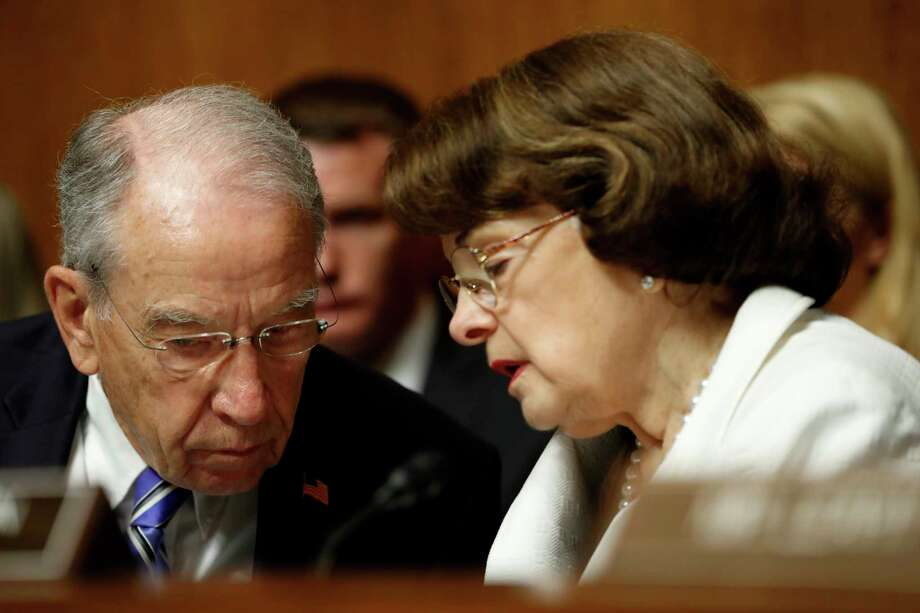 In this photo taken July 12, 2017, Senate Judiciary Committee Chairman Sen. Chuck Grassley, R-Iowa, talks with the Committee's ranking member Sen. Dianne Feinstein, D-Calif., on Capitol Hill in Washington. Glenn Simpson, the co-founder of a Washington opposition research firm that produced a dossier of salacious allegations involving President Donald Trump is to be interviewed by the Senate Judiciary Committee next week.  (AP Photo/Pablo Martinez Monsivais) ORG XMIT: WX114 Photo: Pablo Martinez Monsivais / Copyright 2017 The Associated Press. All rights reserved.
