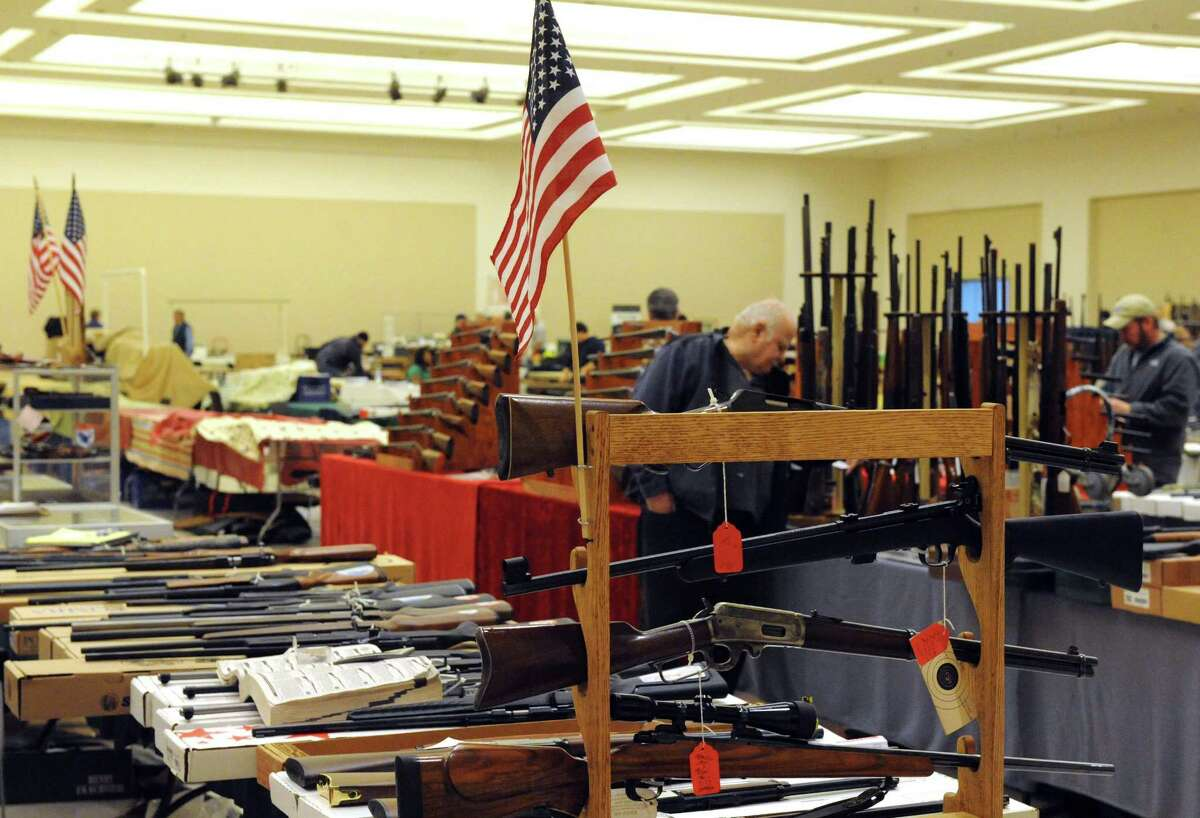 Vendors set up their booths at the New York Gun and New East-coast Arms Collectors Associates, NEACA, Inc. at the Saratoga Springs City Center. This weekend marks the last gun show in Saratoga Springs. (Michael P. Farrell/Times Union)