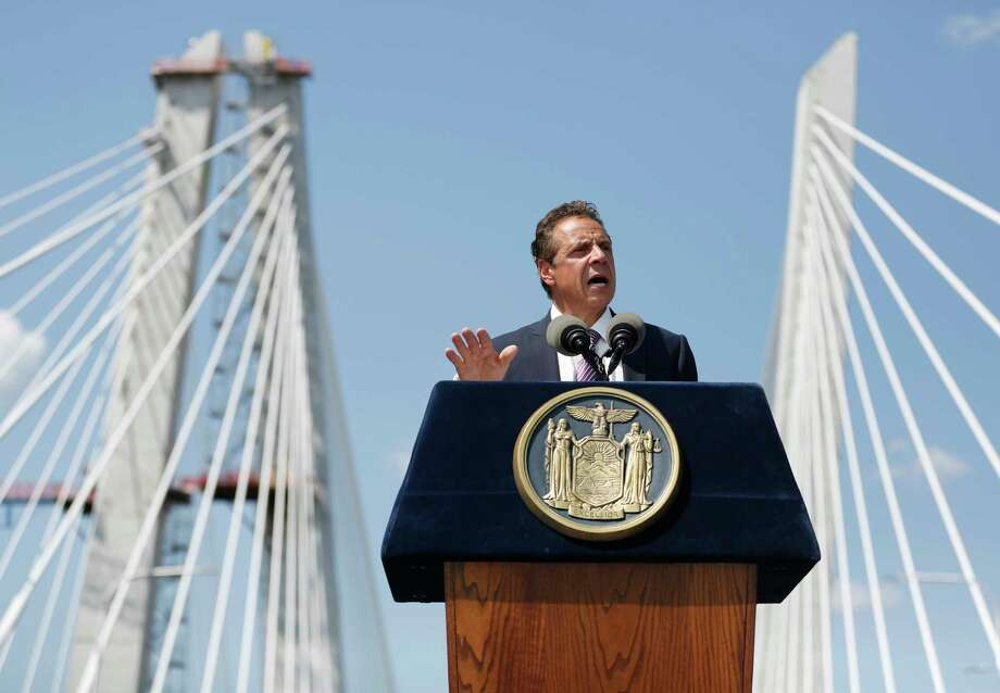 New York Governor Andrew Cuomo speaks during a ribbon cutting ceremony for the Tappan Zee Bridge replacement, called the Gov. Mario M. Cuomo Bridge, on a span of the new bridge near Tarrytown, N.Y., Thursday, Aug. 24, 2017. The event was held a day before vehicles start rolling across the massive new Hudson River span. Cuomo and a host of other dignitaries attended Thursday's ceremony for the 3-mile long bridge, which is being named after Cuomo's late father. (AP Photo/Seth Wenig) ORG XMIT: NYSW109 Photo: Seth Wenig / Copyright 2017 The Associated Press. All rights reserved.