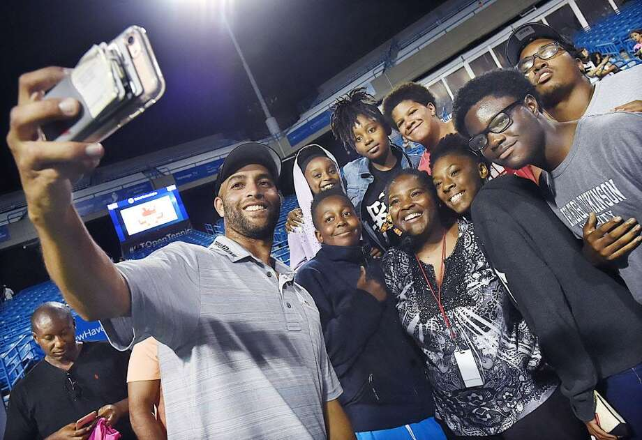 James Blake takes a selfie with Hall Neighborhood House in Bridgeport after defeating Michael Chang, Thursday evening, August 24, 2017, in the Men's Legends championship at the Connecticut Tennis Open at the Stadium Court at the Connecticut Tennis Center in New Haven. Blake, a Bridgeport native, won, 7-5. (Catherine Avalone/Hearst Connecticut Media) Photo: Catherine Avalone / Hearst Connecticut Media / New Haven Register