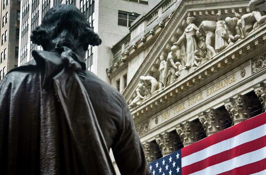 FILE - In this Wednesday, July 8, 2015, file photo, Federal Hall's George Washington statue stands near the flag-covered pillars of the New York Stock Exchange. Stocks are rising in early trading on Wall Street, Thursday, Aug. 24, 2017, after several retailers reported earnings that were far better than analysts were expecting. (AP Photo/Bebeto Matthews, File) Photo: Bebeto Matthews, STF / Copyright 2017 The Associated Press. All rights reserved.