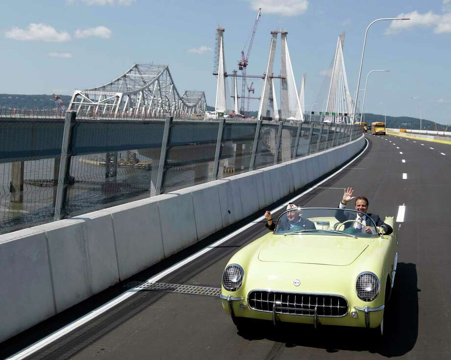 """New York Gov. Andrew Cuomo, right, and Armando """"Chick"""" Galella cross a span of the Tappan Zee Bridge replacement, called the The Gov. Mario M. Cuomo Bridge, near Tarrytown, N.Y., Thursday, Aug. 24, 2017. Galella also participated in the opening ceremonies of the original Tappan Zee Bridge in 1995. A ribbon-cutting ceremony was held a day before vehicles start rolling across the massive new Hudson River span. (AP Photo/Seth Wenig) Photo: Seth Wenig, STF / Copyright 2017 The Associated Press. All rights reserved."""