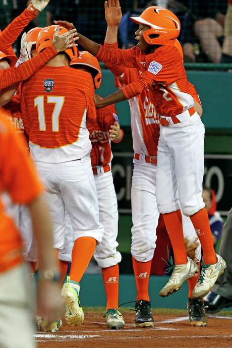 Collin Ross (17) is greeted by a happy bunch of his Lufkin teammates after hitting a three-run homer in the first inning of the Texans' 14-4 victory over Fairfield (Conn.) in the Little League World Series on Thursday night. Photo: Gene J. Puskar, STF / Copyright 2017 The Associated Press. All rights reserved.