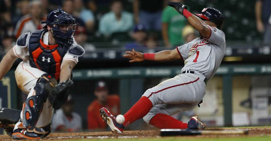 Washington Nationals Wilmer Difo (1) slides in to score a run on Anthony Rendon's sacrifice fly in the eleventh inning of an MLB baseball game at Minute Maid Park, Thursday, Aug. 24, 2017, in Houston.  ( Karen Warren / Houston Chronicle ) Photo: Karen Warren/Houston Chronicle