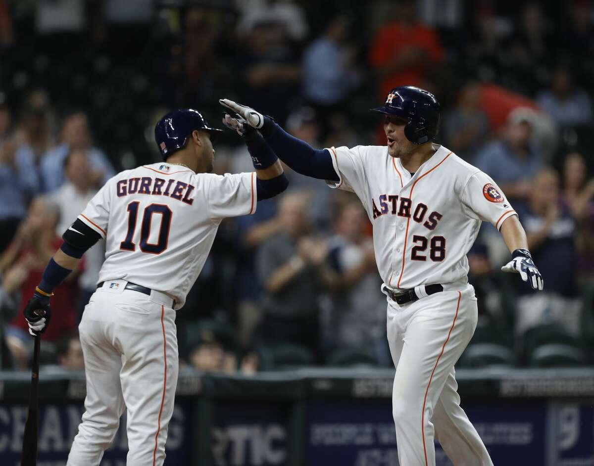 Houston Astros J.D. Davis (28) celebrates his home run with Yuli Gurriel (10) in the eleventh inning of an MLB baseball game at Minute Maid Park, Thursday, Aug. 24, 2017, in Houston. ( Karen Warren / Houston Chronicle )