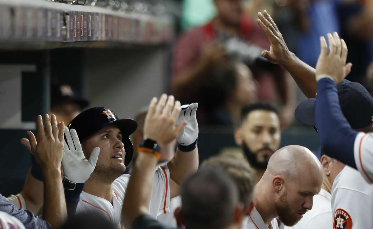 Houston Astros J.D. Davis (28) celebrates his home run with teammates in the eleventh inning of an MLB baseball game at Minute Maid Park, Thursday, Aug. 24, 2017, in Houston. ( Karen Warren / Houston Chronicle )