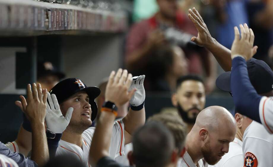 Houston Astros J.D. Davis (28) celebrates his home run with teammates  in the eleventh inning of an MLB baseball game at Minute Maid Park, Thursday, Aug. 24, 2017, in Houston.  ( Karen Warren / Houston Chronicle ) Photo: Karen Warren/Houston Chronicle
