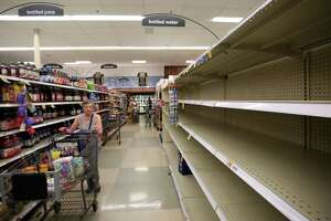 Consumers found empty shelves Thursday in the bottled water section at the Kroger on Buffalo Speedway. The store is expecting truckloads of water today before Harvey reaches landfall.