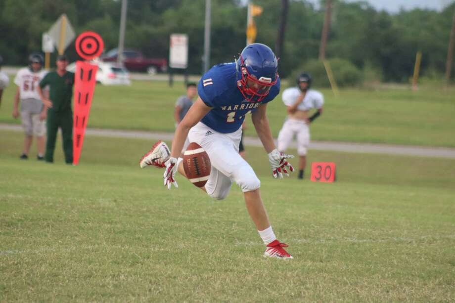 First Baptist Christian Academy's Stephen Shaklovitz can't quite come up with this deep toss by quarterback Jonathan Kirk during Thursday's night scrimmage. But by night's end, Shaklovitz would haul in two TD passes. Photo: Robert Avery
