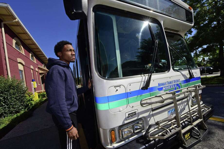 Jesse Lawrence, an Norwalk Community College student, takes the train from Bridgeport on Friday October 7, 2016, to the South Norwalk station in Norwalk, Conn. where he catches the Wheels bus shuttle to campus as part of his commute. Some college students are eligible for free bus and rides by simply showing a valid student ID and a something called a U-Pass CT. The U-Pass CT program is primarily funded through a $20 per semester student fee assessed by each of the 15 participating schools. Photo: Erik Trautmann / Hearst Connecticut Media / Norwalk Hour