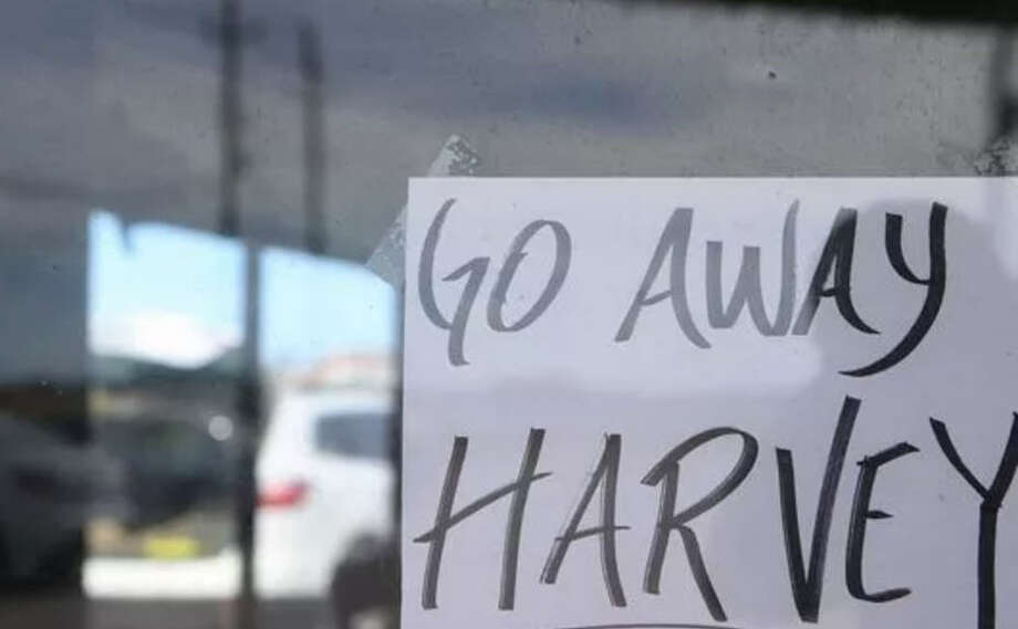 Residents and business owners in Corpus Christi refuse to remain quiet while Hurricane Harvey bears down on the coastal town. Photo: Gabe Hernandez/Corpus Christi Caller-Times Via AP
