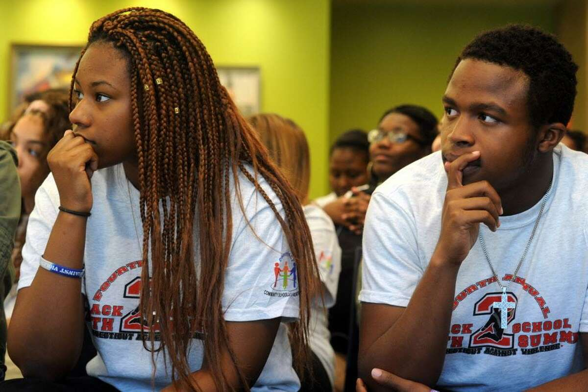 Ryanna Johnson and Caled Bailey, students from Fairchild Wheeler Interdistrict Magnet School listen to speakers at the Connecticut Against Violence 4th Annual Bridgeport Back to School Youth Summit, held at Housatonic Community College in Bridgeport, Conn. Sept. 23, 2016.