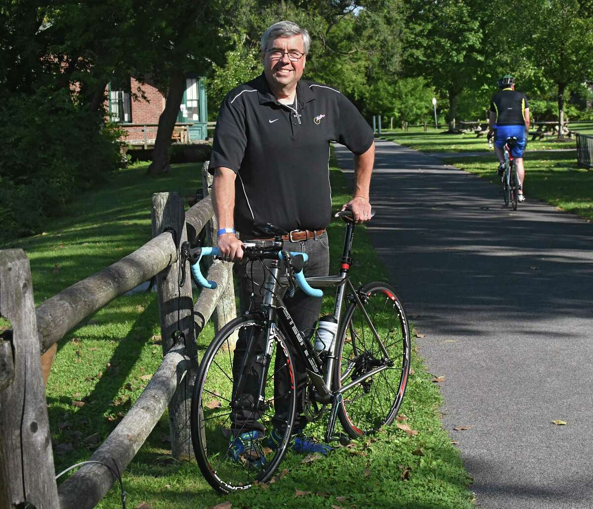 Bill Monaghan, a GE engineer who designs 3D printers, stands with one of his favorite bikes at Lions Park on Thursday, Aug. 24, 2017 in Niskayuna, N.Y. He coaches diabetics for a fundraising ride from Saratoga to Lake George. (Lori Van Buren / Times Union)