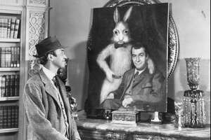 "FILE--Jimmy Stewart admires his friend and companion, ""Harvey"", a six-foot imaginary white rabbit in the 1950 film.  Hollywood columnist Army Archerd reported the actor died Wednesday, July 2, 1997 at his home in Beverly Hills, Ca.  He was 89. (AP Photo/File)"