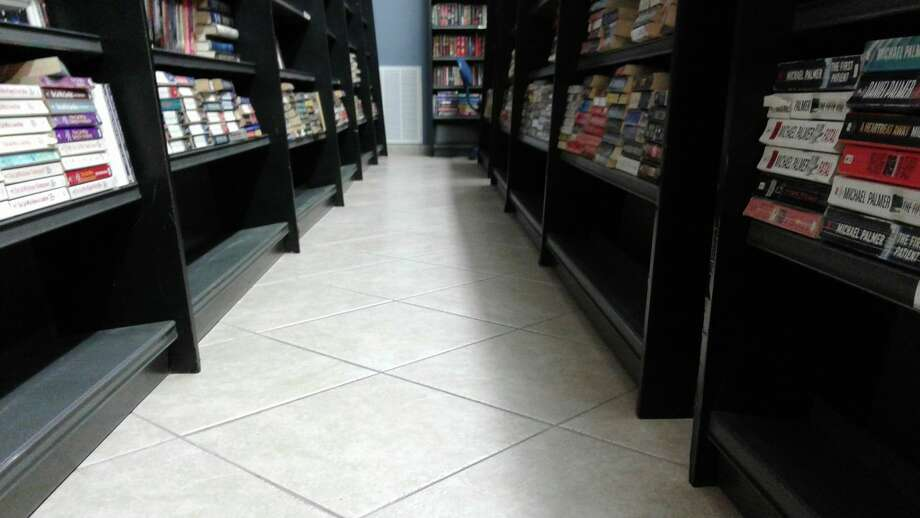 At Galveston Bookshop, books have been moved off the lower shelves in case floodwater seeps in. The store is closing for the weekend.