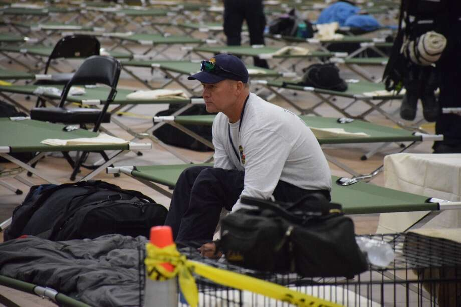 First responders from across the state poured into the AT&T Center grounds Friday to set up a command center in response to Hurricane Harvey. Photo: Caleb Downs / San Antonio Express-News