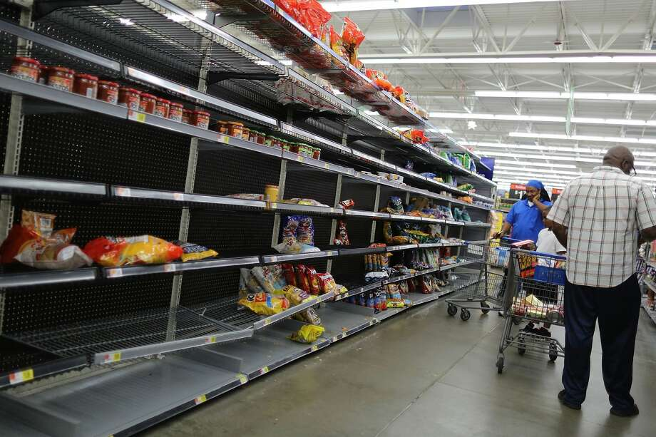 The chips and other bagged foods section of a Walmart store is almost empty as people prepare for the possible arrival of Hurricane Harvey on August 24, 2017 in Houston, Texas.  Hurricane Harvey has intensified into a hurricane and is aiming for the Texas coast with the potential for up to 3 feet of rain and 125 mph winds. Photo: Joe Raedle/Getty Images