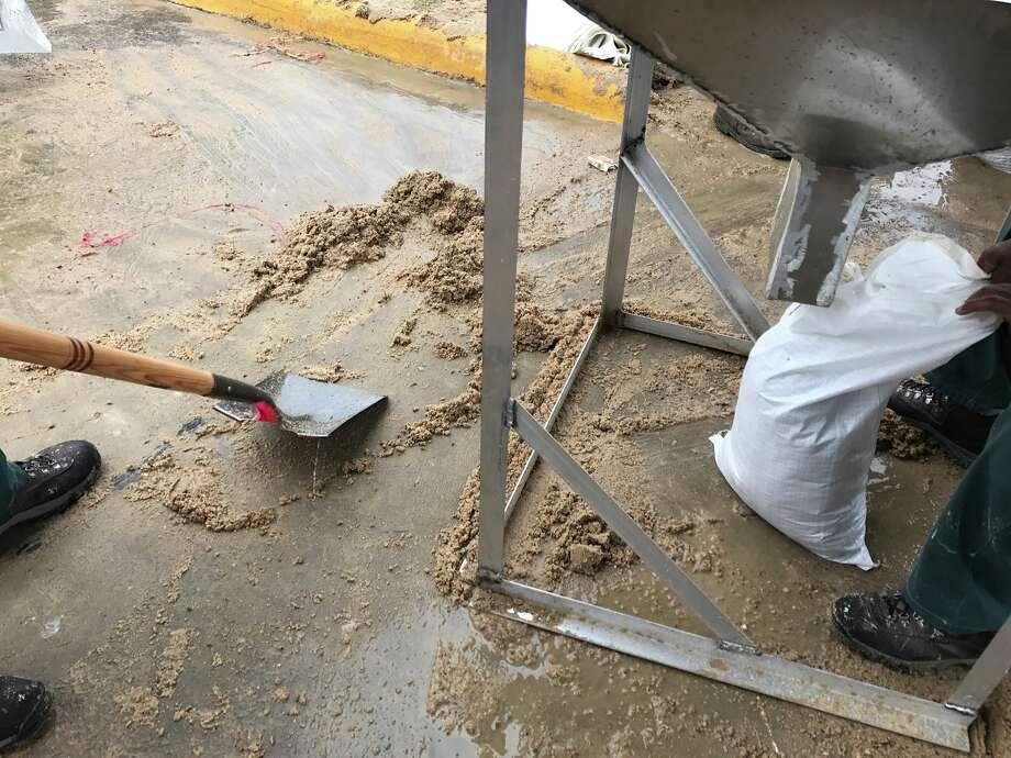 The Port Arthur Civic Center runs out of sand for sandbags.