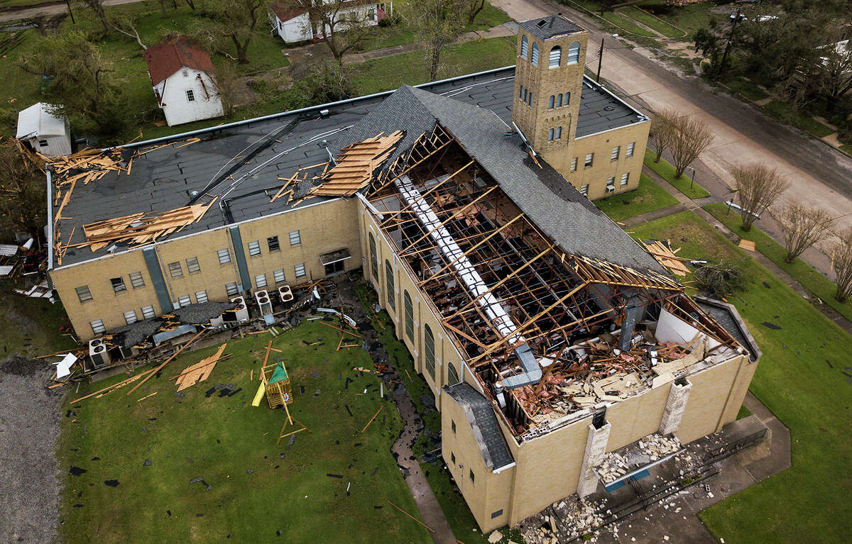This photo shows The First Baptist Church roof after it was peeled off by Hurricane Harvey in Refugio, Texas, on Monday, Aug. 28, 2017. (Nick Wagner/Austin American-Statesman via AP)