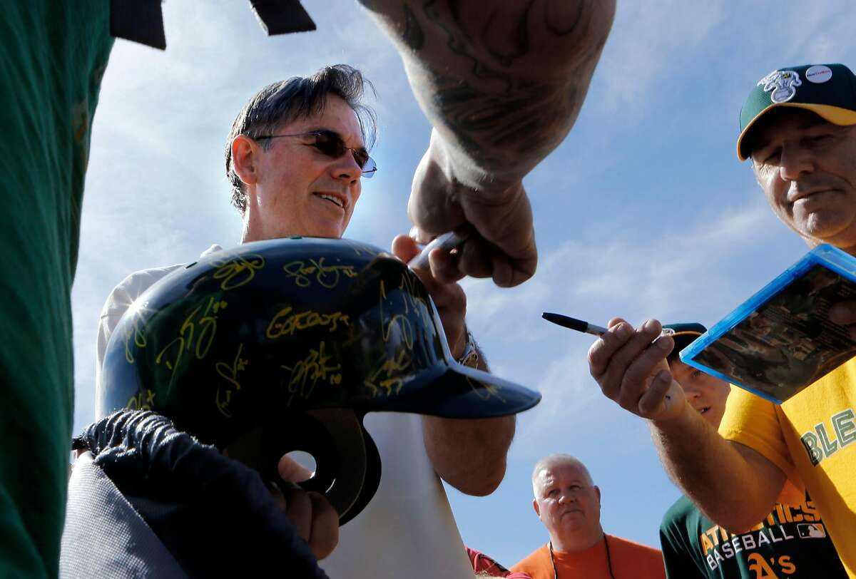 A's general manager BIlly Beane signs autographs for fans at the Papago Baseball facility in Phoenix, Arizona on Saturday Feb. 22, 2014. The Oakland Athletics continue their spring training schedule in the Arizona desert in preparation for the 2014 MBL season.