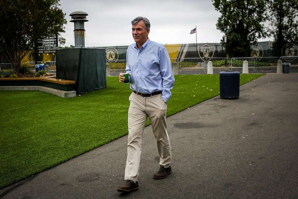 Billy Beane walks through the Oakland Alameda County Coliseum during a portrait session in Oakland, Calif., on Monday, Aug. 14, 2017.