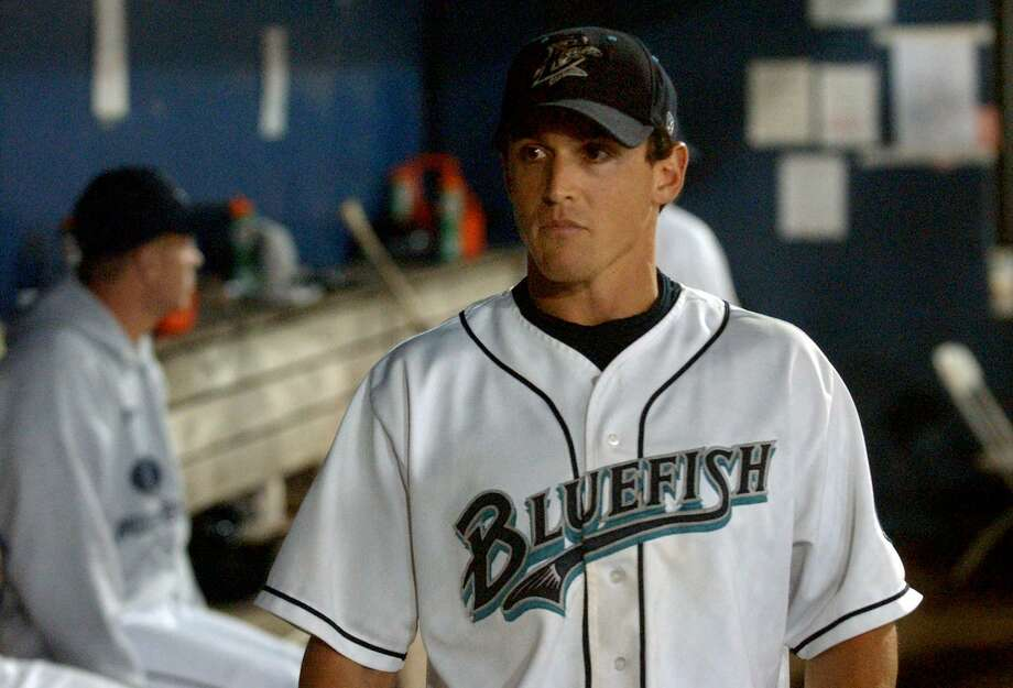 Adam Greenberg in the dugout during his Bridgeport Bluefish days in 2011. Photo: Christian Abraham / Hearst Connecticut Media / Connecticut Post