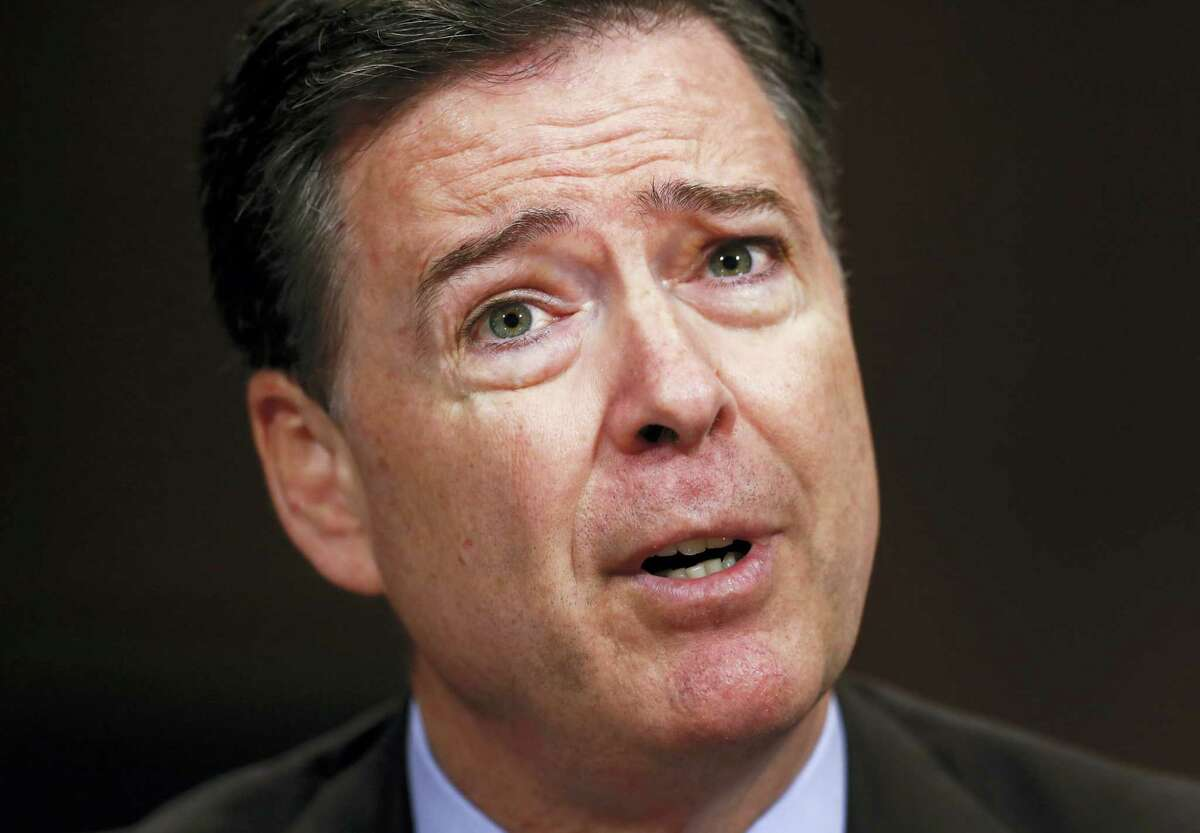 """In this Wednesday, May 3, 2017, photo, then-FBI Director James Comey testifies on Capitol Hill in Washington, before a Senate Judiciary Committee hearing. A nonprofit issues group is labeling James Comey a political """"showboat"""" in an advertisement set to air on television Thursday, the day the former FBI director testifies on Capitol Hill."""