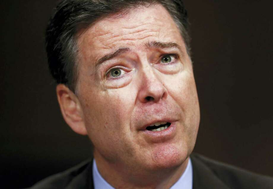 """In this Wednesday, May 3, 2017, photo, then-FBI Director James Comey testifies on Capitol Hill in Washington, before a Senate Judiciary Committee hearing.  A nonprofit issues group is labeling James Comey a political """"showboat"""" in an advertisement set to air on television Thursday, the day the former FBI director testifies on Capitol Hill. Photo: AP Photo/Carolyn Kaster   / Copyright 2017 The Associated Press. All rights reserved."""