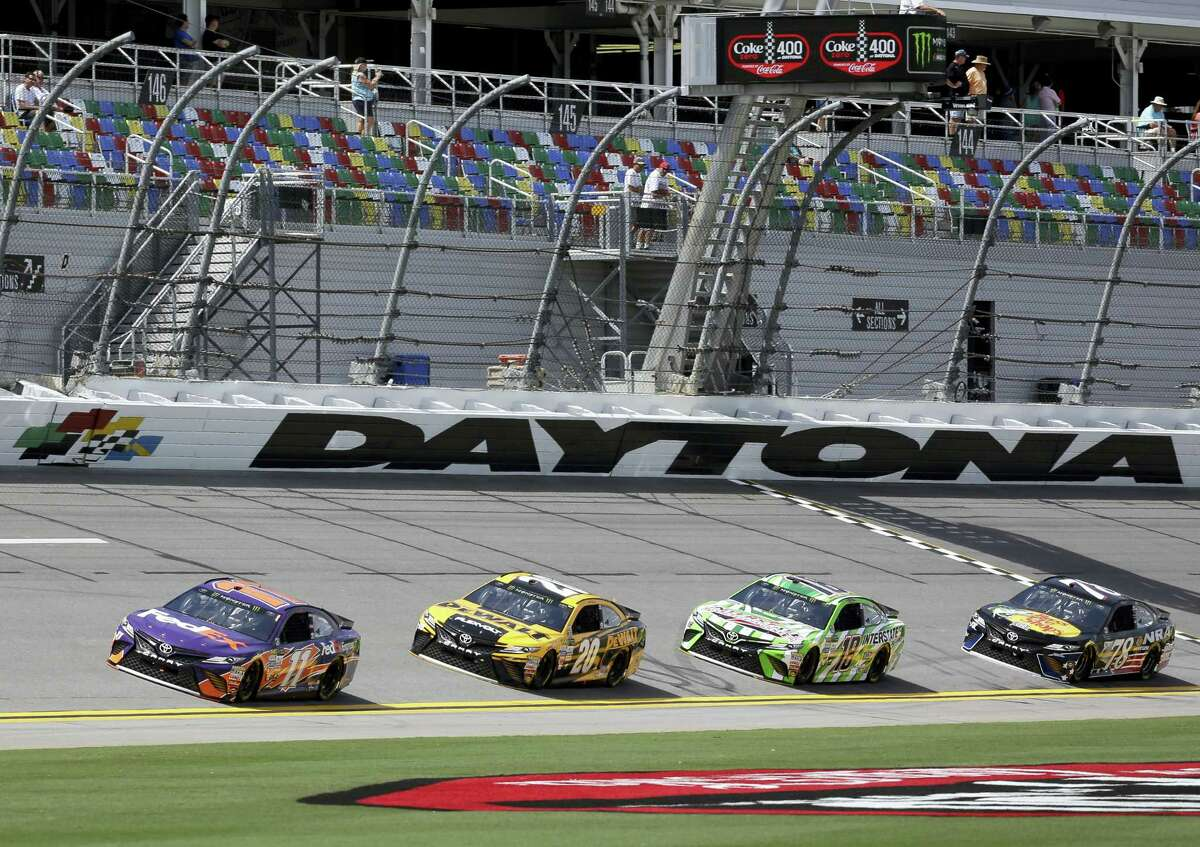 Drivers make their way through a lap during practice at Daytona International Speedway.