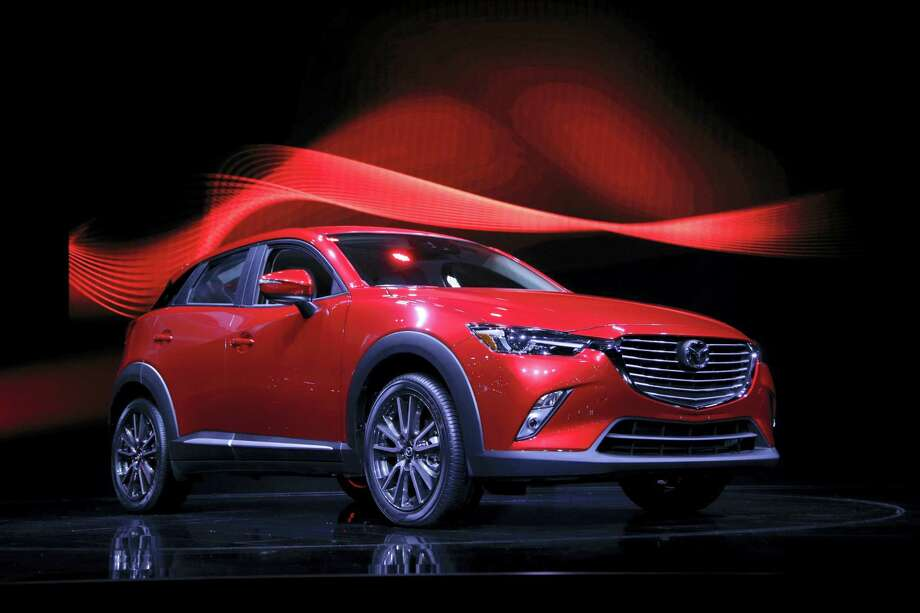 In this Nov. 19, 2014, file photo, the 2016 Mazda CX-3 is unveiled at the Los Angeles Auto Show, in Los Angeles. Mazda is recalling nearly 228,000 cars in the U.S. because the parking brake may not fully release or could fail to hold the cars, increasing the risk of a crash. The recall covers certain Mazda 6 cars from the 2014 and 2015 model years and the Mazda 3 from 2014 through 2016. Photo: AP Photo/Jae C. Hong, File   / Copyright 2017 The Associated Press. All rights reserved.