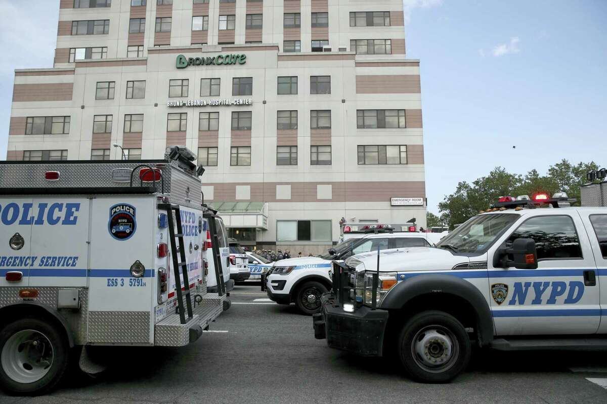 Police vehicles converge on Bronx Lebanon Hospital in New York after a gunman opened fire there on Friday, June 30, 2017. The gunman, identified as Dr. Henry Bello who used to work at the hospital, apparently took his own life after shooting others, authorities said.