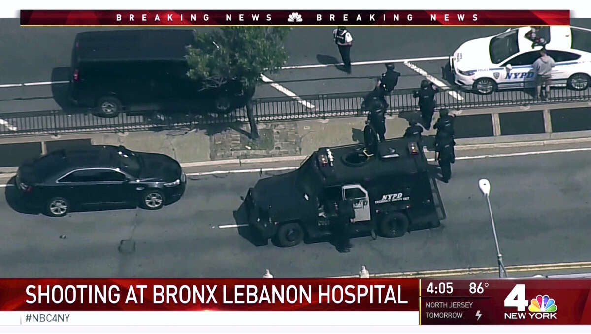In this image taken from video provided by WNBC 4 New York, emergency personnel converge on Bronx Lebanon Hospital in New York, after a gunman opened fire there on Friday, June 30, 2017.