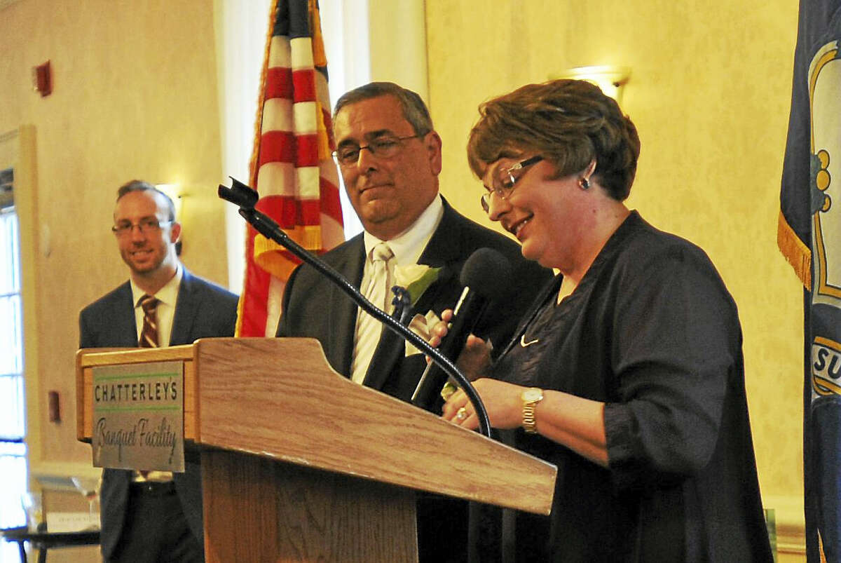 The Northwest Connecticut Chamber of Commerce recognized community members for their good works Thursday with its annual Celebration of Success. Above, Susan and Tim Cook, owners of the Cook Funeral Home in Torrington, receive the Business Leader Award during the celebration.