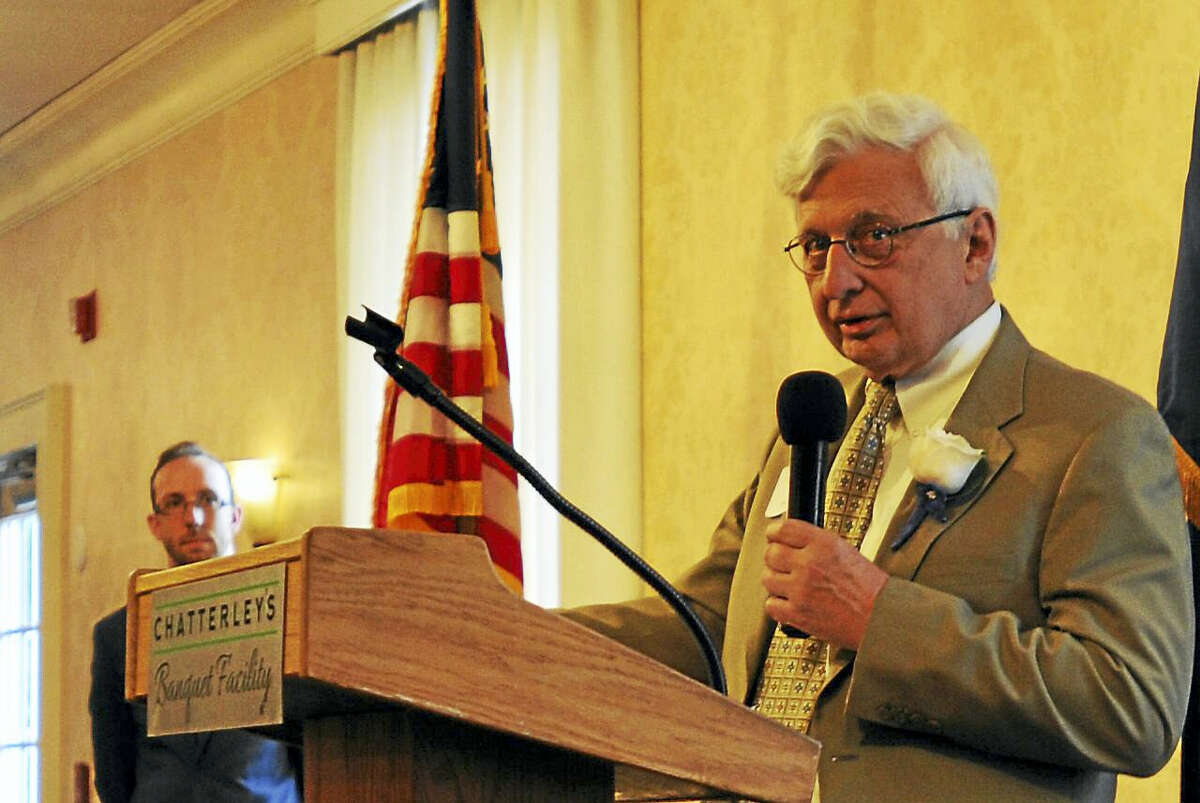 The Northwest Connecticut Chamber of Commerce recognized community members for their good works Thursday with its annual Celebration of Success. Above, Ken Merz of O&G Industries speaks after receiving the Community Leader Award.